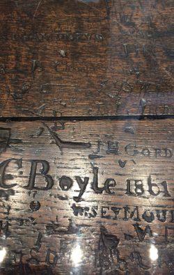 Graffiti on a nineteenth-century school desk, new Charterhouse Museum, EC1