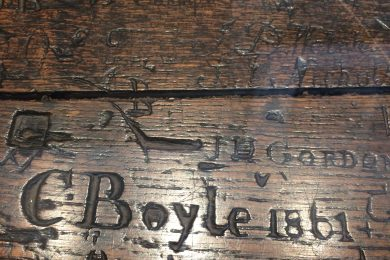 Graffiti on a nineteenth-century school desk, new Charterhouse Museum, EC1